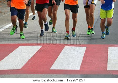 Many Marathon Athletes Run Fast Over The Pedestrian Crossing In