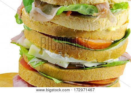 Giant Sandwich Stuffed With Many Layers Of Bread With Lettuce To