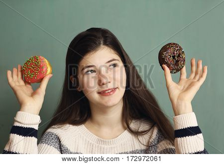 Teenager Girl With Doughnuts