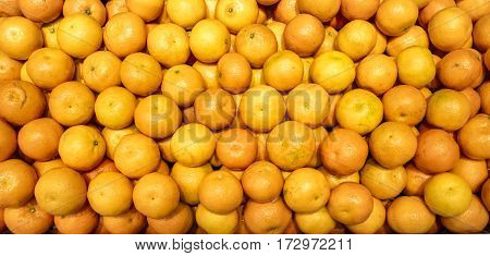 A large number of small mandarin orange in the supermarket and shop. A healthy and wholesome food