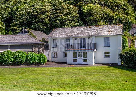 North Devon coast. Two-storey white house on the north coast of Devon. The village of Lynmouth. UK