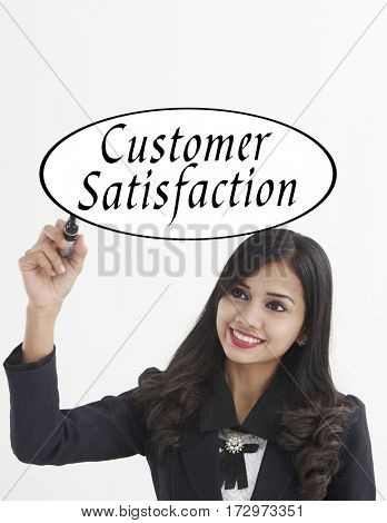 businesswoman holding a marker pen writing -customer satisfaction