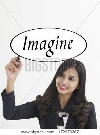 businesswoman holding a marker pen writing -imagine