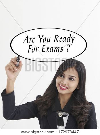 businesswoman holding a marker pen writing -are you ready for exam