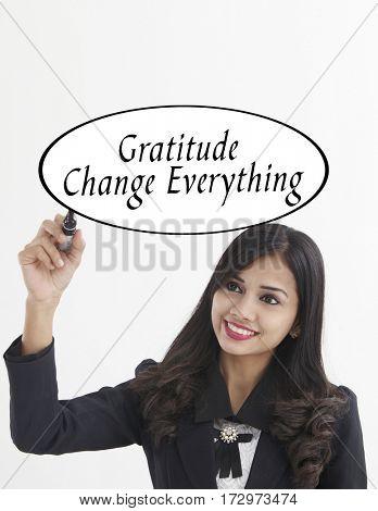 businesswoman holding a marker pen writing -gratitude