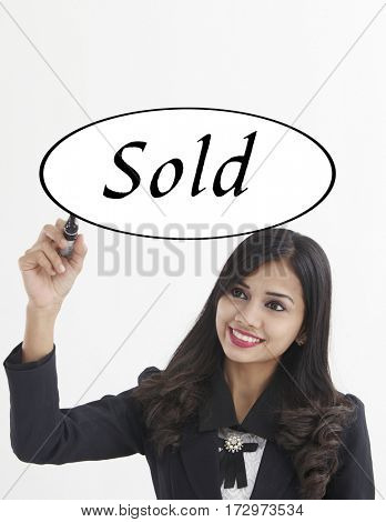 businesswoman holding a marker pen writing -sold