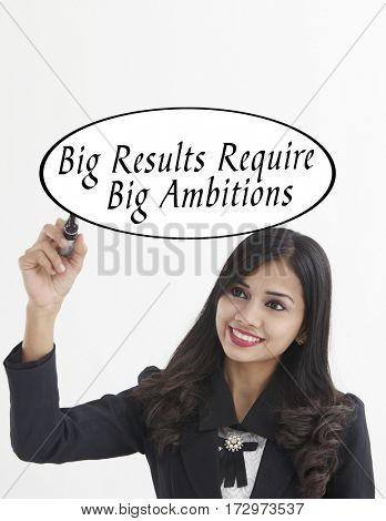 businesswoman holding a marker pen writing -big results require big ambitions