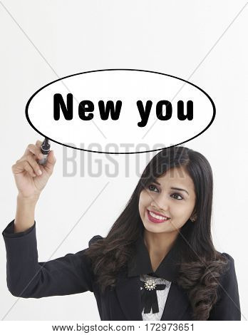 businesswoman holding a marker pen writing -new you
