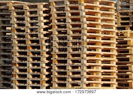 stock of wooden euro pallets on warehouse backyard