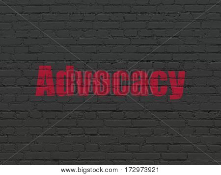 Law concept: Painted red text Advocacy on Black Brick wall background