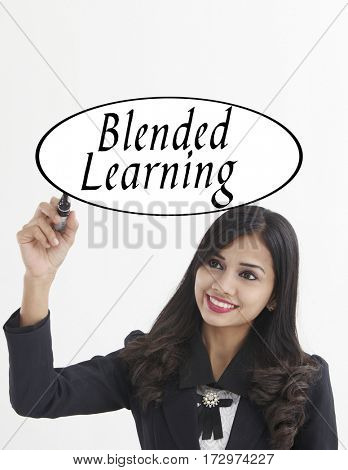 businesswoman holding a marker pen writing -blended learning
