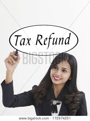 businesswoman holding a marker pen writing -tax refund