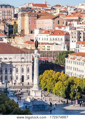 LISBON PORTUGAL - JANUARY 10 2017: Column of Pedro IV on Rossio Square (Pedro IV Square) in Lisbon as seen from Elevador da Santa Justa viewpoint.