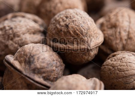 Background or pattern of many close walnuts. Close-up or macro photo.