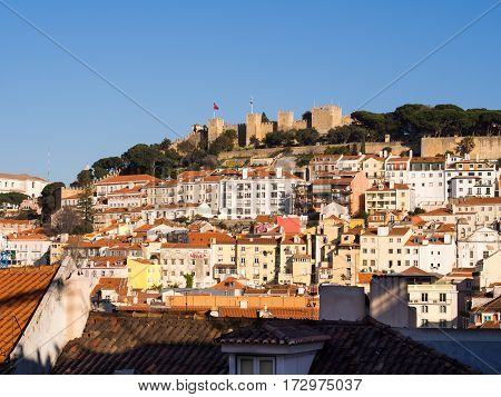 LISBON PORTUGAL - JANUARY 19 2017: 2017: Sao Jorge Castle in Lisbon with surrounding architecture.