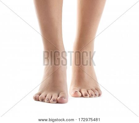 Female feet with brown pedicure isolated on white