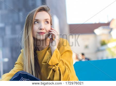 Young woman on smartphone, outside - outdoor