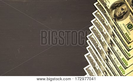 Dollars On A Wooden Background. Dollar Top View .heap Of Dollars