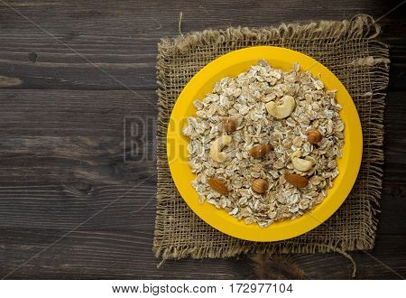 Muesli With Nuts (hazelnuts,  Almonds,cashew). Muesli On A Wooden Table. Muesli Top View . Healthy F