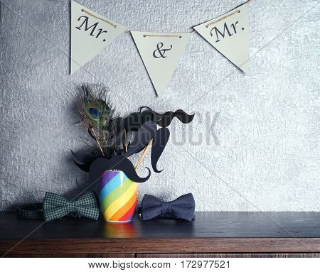 Wedding accessories on table and grey wall background