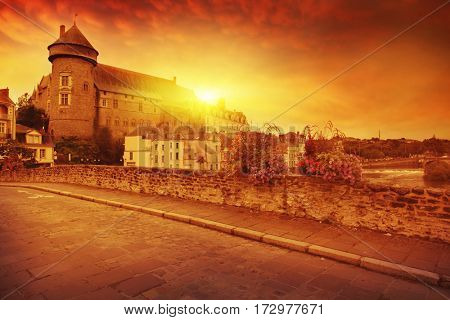 Old town in Europe and red sunset.