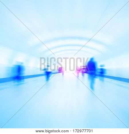 Abstract image of motion blurred people walking in subway station.