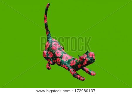 Cat handmade colored decoration isolated on green color