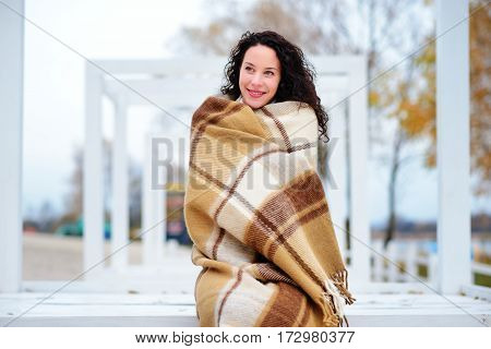 Beautiful Girl Dressed In Plaid Autumn Beach