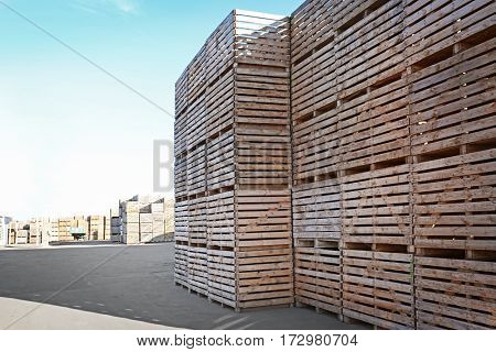 Wooden boxes in open-air warehouse on sunny day