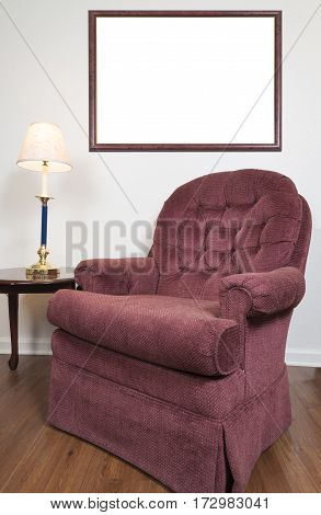 Vertical shot of a Blank Picture Frame Behind a Chair In a Home Setting.