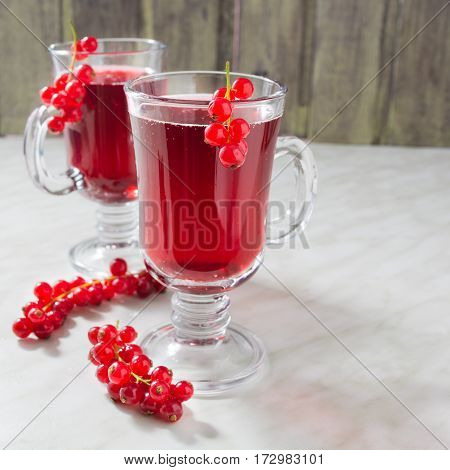 Two cup of red currant aerated lemonade with copy space