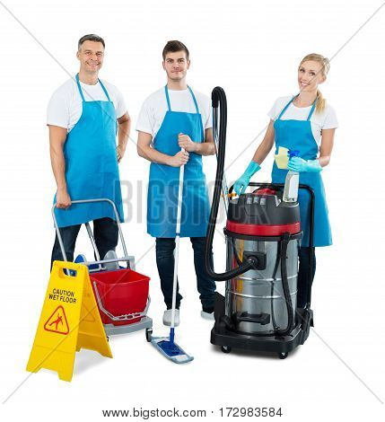Group Of Janitors With Their Cleaning Equipment Standing On White Background