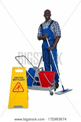 Young African Male Janitor Cleaning Floor With Mop And Cleaning Equipment On White Background
