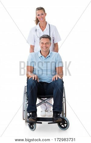 Portrait Of A Female Doctor With A Handicapped Male Patient On Wheelchair