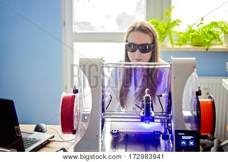 Woman Working With Laser Engraver