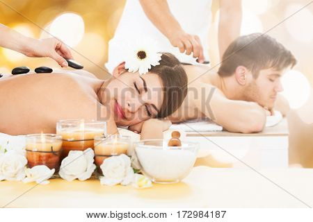 Young Couple In A Spa Getting Hot Stone Therapy
