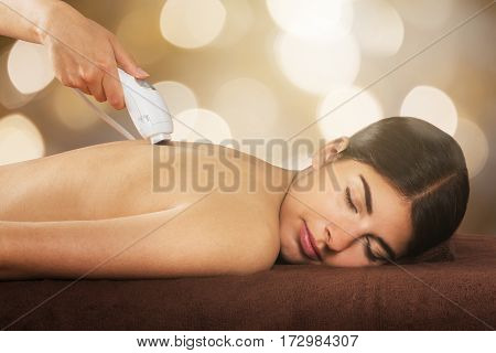 Woman Receiving Laser IPL Treatment At Beauty Spa