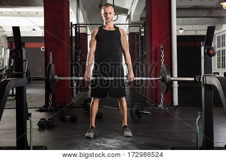 Young Man Doing Barbell Deadlift In The Gym