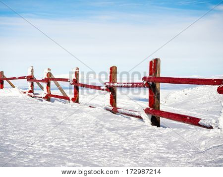 Red Fence At The Top Of The Mountain