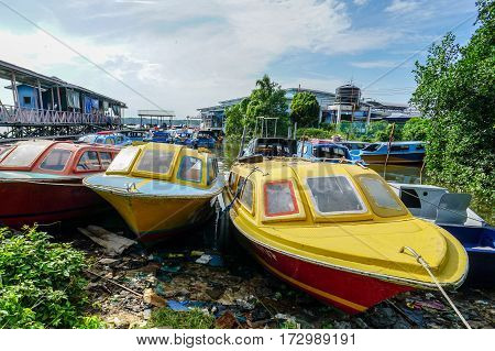 Menumbok,Sabah-Aug 19,2016:Empty boats park on the land in Menumbok,Sabah,Borneo.It is a passenger taxi service operator & tourist attraction to Labuan Pearl Of Borneo.