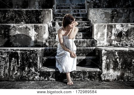 Woman In Frustrated Depressed Sitting On Stairs, Crying And Contemplating Suicide, In Scary Abandone