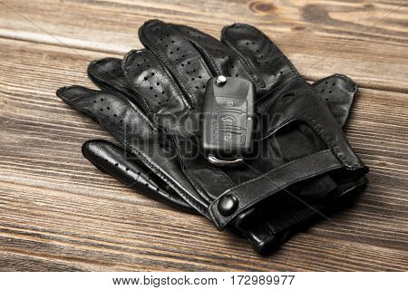 Car keys and driving gloves