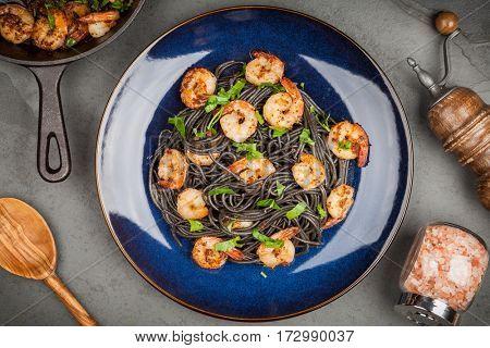 Black pasta with shrimps