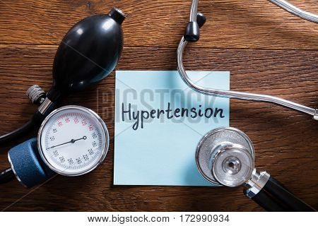 A Medical Concept Of Hypertension With Stethoscope And Tonometer On Wooden Desk