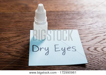 Dry Eyes Concept With Eye Drops On Wooden Desk