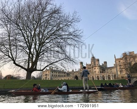 CAMBRIDGE - FEBRUARY 18, 2017: Punting on the River Cam in front of St John's College at The University of Cambridge in Cambridge, Cambridgeshire, UK.