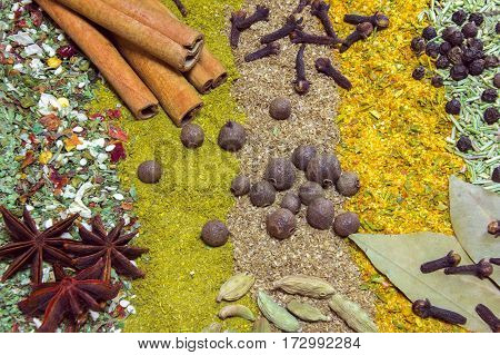 various spices on a table as a background