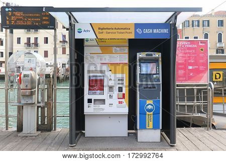 VENICE ITALY - JANUARY 09; Self service ticket point for Actv network and cash machine for tourists in Venice Italy - January 09 2017: Actv is water bus network with 19 scheduled lines that serve locals and tourists within Venice.