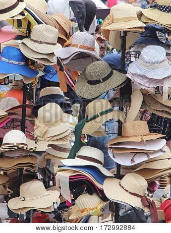 Colorful summer hats sold on market stall