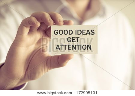 Businessman Holding Good Ideas Get Attention Message Card